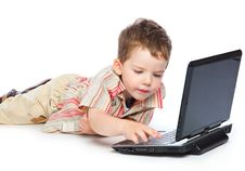 Free A Cute Boy Is Typing On A Laptop Stock Photography - 18215182