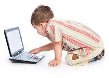 Free A Cute Boy Is Typing On A Laptop Royalty Free Stock Photo - 18215185
