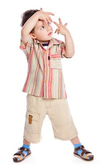Free A Cute Boy Represents Something In A Studio Royalty Free Stock Photography - 18215187