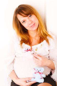 Free Pregnant Woman With Soft Toys Royalty Free Stock Image - 18221126