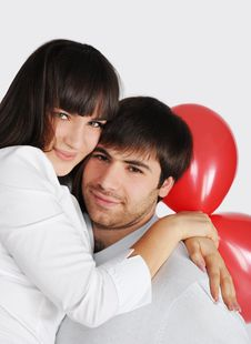 Free Young Love Couple, Red Balloons Behind Royalty Free Stock Photo - 18221625