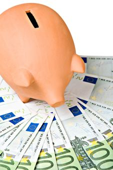 Clay Piggy Bank On A Pile Of European Banknotes Royalty Free Stock Photo