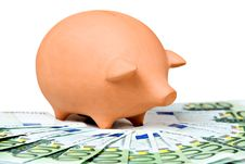 Clay Piggy Bank On A Pile Of European Banknotes Stock Image