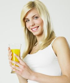 Woman With A Glass Of Juice Royalty Free Stock Photography
