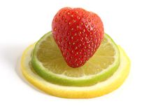 Strawberry On Lemon And Lime Slices Royalty Free Stock Images
