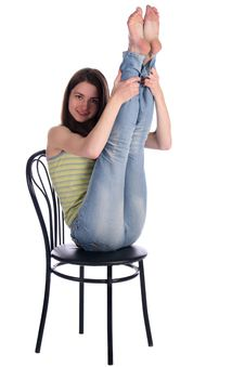 Free Girl Sit On Stool Take Legs Up. Royalty Free Stock Images - 18225469