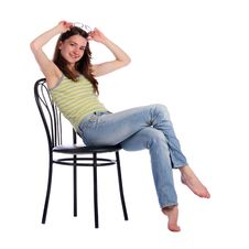 Free Girl Sit On Stool Taking Off Glasses. Royalty Free Stock Photo - 18225885
