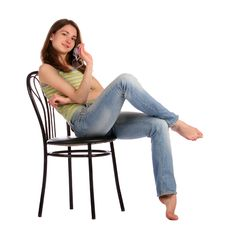Free Girl In Green Stripy Top Sit On Stool. Stock Images - 18225904