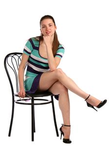 Free Girl In Stripy Blue Dress Posing On Stool. Stock Photography - 18226012