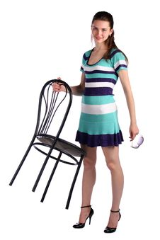 Free Girl In Stripy Blue Dress Holds Stool. Stock Image - 18226061