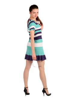 Free Girl In Stripy Blue Dress Stands Turned Around. Royalty Free Stock Photo - 18226085