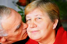 Free Happy Senior Couple Kissing Stock Photos - 18226093