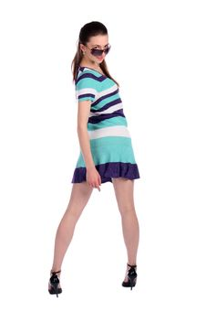 Free Girl In Stripy Blue Dress Turns Around. Royalty Free Stock Images - 18226099