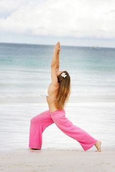 Free Young Woman Doing Yoga On Beach Stock Images - 18226604