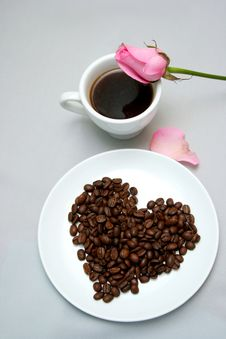 Cup Of Coffee With Heart From Coffee Beans Stock Images
