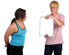 Free Young Man Shows Blank Psges For Girl. Stock Image - 18228121