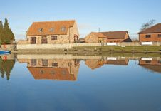 Free Houses Next To A River With Reflection Stock Image - 18229731