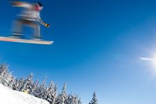 Male Snowboarder Catches Big Air. Royalty Free Stock Image