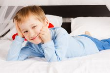 Free Boy  Lies On A Bed In A Comfortable Situation Stock Images - 18230984