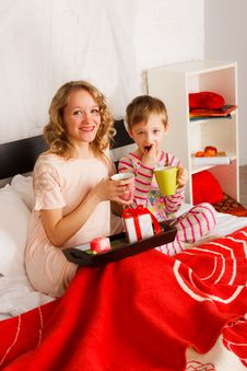 Free Woman With Her Son Breakfast In A Bed Stock Image - 18231021