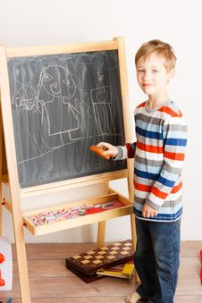 Free Boy Draws A Chalk On A Board Stock Images - 18231034