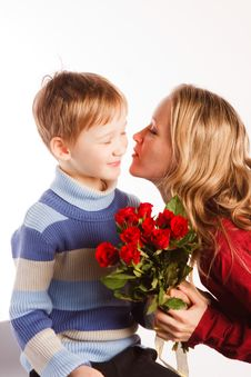 Woman With A Son And With The Bouquet Of Red Roses Stock Photography