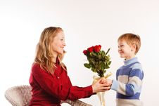 Woman With A Son And With The Bouquet Of Red Roses Royalty Free Stock Photos