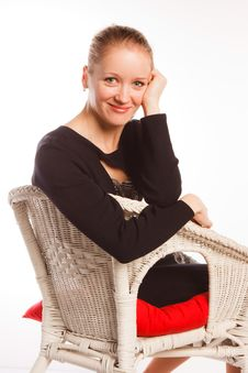 Woman Sits In An Arm-chair On A White Background Stock Images