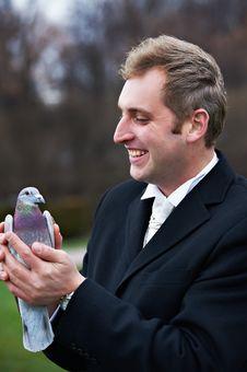 Free Joyful Groom With Pigeons On Hands Stock Image - 18232271