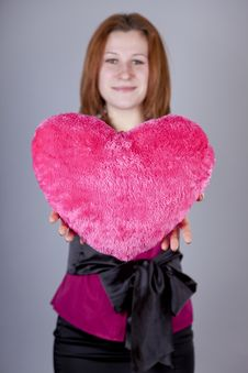 Free Red-haired Girl With Heart Toy. Royalty Free Stock Image - 18234956