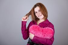 Free Red-haired Girl With Heart Toy. Royalty Free Stock Images - 18234969
