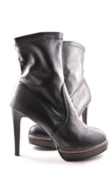 The Feminine Leather Boots On High Heel. Stock Images