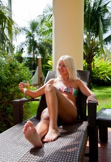 Free Blond Taking Sun Bath In Tha Garden Stock Image - 18238041