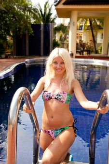 Attractive Woman On The Swimming Pool Ladder Royalty Free Stock Photo