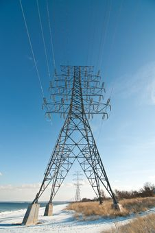 Free Electrical Tower (Electricity Pylon) Beside A Lake Stock Photo - 18240850