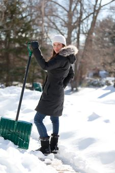 Free Woman Shoveling Sidewalk Royalty Free Stock Images - 18244339