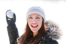 Free Smiling Woman Throwing Snowball Stock Image - 18244481