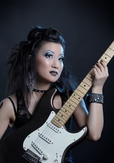 Woman Rock With Guitar Stock Images