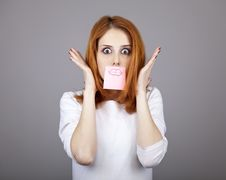 Free Portrait Of Red-haired Girl With Stickers On Mout Royalty Free Stock Photography - 18244577