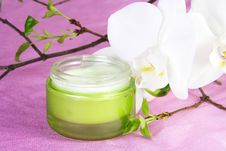 Free Moisturizer With White Orchid Stock Images - 18245114