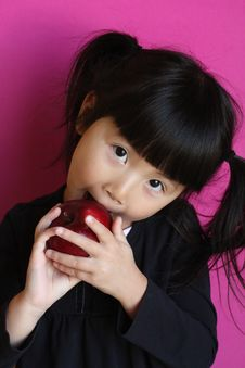 Free Chinese Asian Girl Eating  Apple Stock Photos - 18245453