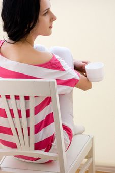 Free Caucasian Young Woman Sitting On The Chair Royalty Free Stock Photography - 18246547
