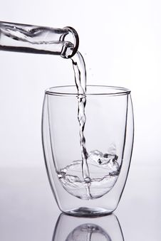 Water Falling Into Glass Stock Image