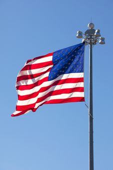 Free United States Flag In Front Of Clear Blue Sky Royalty Free Stock Photography - 18246927