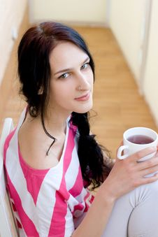 Free Caucasian Young Woman With Cup Of Tea Royalty Free Stock Image - 18247086
