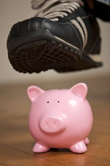 Free Breaking The Piggy Bank Stock Image - 18247151