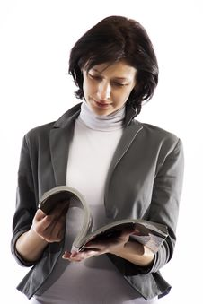 Free A Woman Reading A Glossy Magazine Stock Photos - 18248913