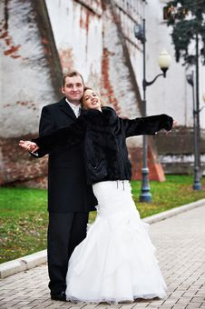Happy Bride And Groom Near Ancient Wall Royalty Free Stock Images
