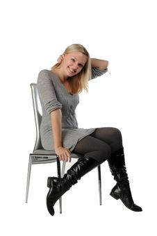 Free Beautiful Blonde Woman Sit On Chair Royalty Free Stock Images - 18249519