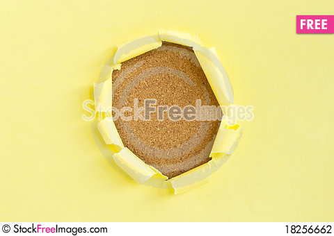Free Yellow Torn Paper Over Cork Board Stock Photography - 18256662